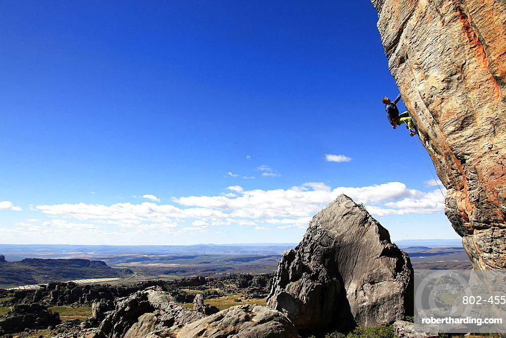 A rock climber scales a difficult route at Rocklands, Western Cape, South Africa, Africa