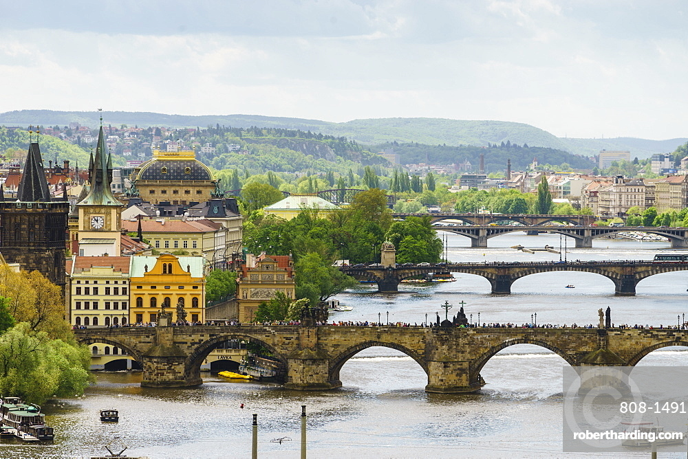 Prague cityscape looking down the Vltava River at its bridges connecting the Old Town to Mala Strana, Prague Castle and Hradcany, Prague, Czech Republic, Europe