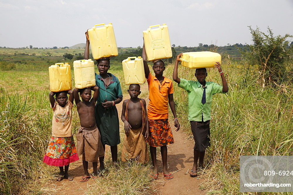 Ugandan children fetching water, Masindi, Uganda, Africa