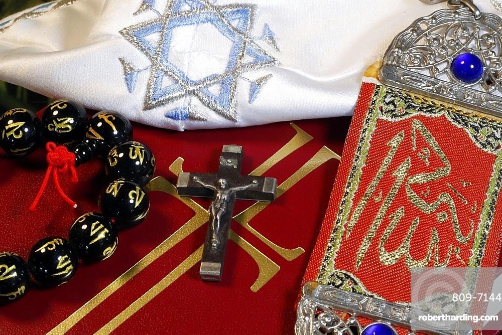 Christianity, Buddhism, Islam and Judaism, interfaith symbols of Bible, crucifix, Kippah, Allah monogram and Mala, Haute-Savoie, France, Europe