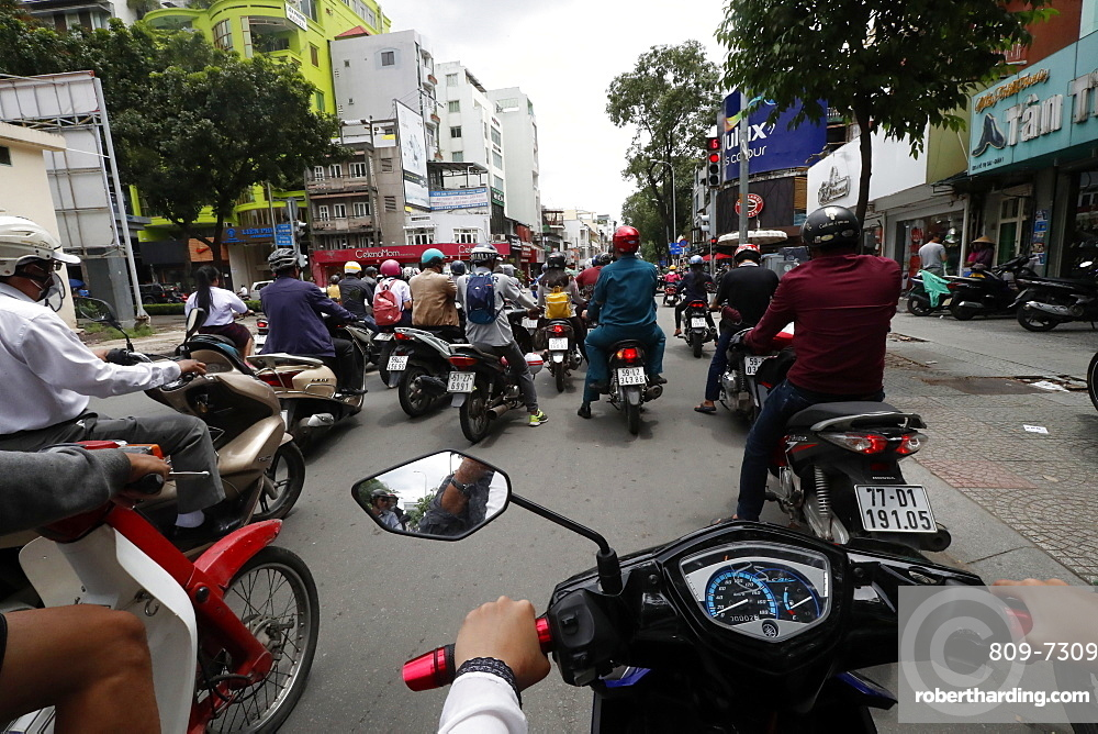 Vietnamese people on motorbikes in traffic, Ho Chi Minh City, Vietnam, Indochina, Southeast Asia, Asia
