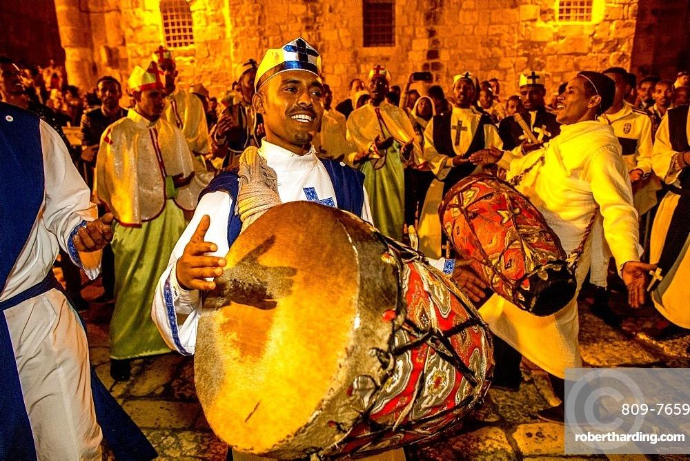 Ethiopian Orthodox Christians celebrating Easter vigil outside the Church of the Holy Sepulchre, Jerusalem, Israel, Middle East