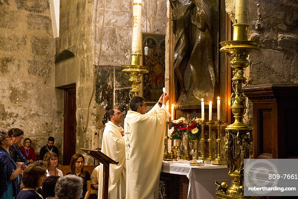 Catholic pilgrims worshipping at the Church of the Holy Sepulchre, Jerusalem, Israel, Middle East