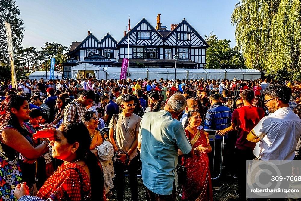 Queue outside the temple for the Janmashtami Hindu festival at Bhaktivedanta Manor, Watford, England, United Kingdom, Europe