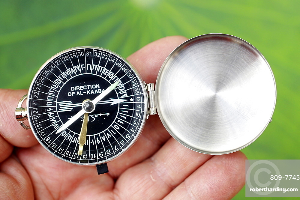 Close-up of a Muslim using a Qibla compass to indicate the direction of Al Kaaba, Cambodia, Indochina, Southeast Asia, Asia