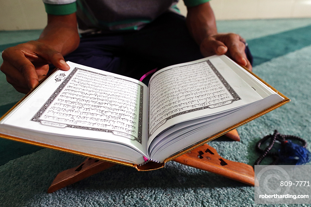 Muslim reading the Quran in Mosque, Ho Chi Minh City, Vietnam, Indochina, Southeast Asia, Asia