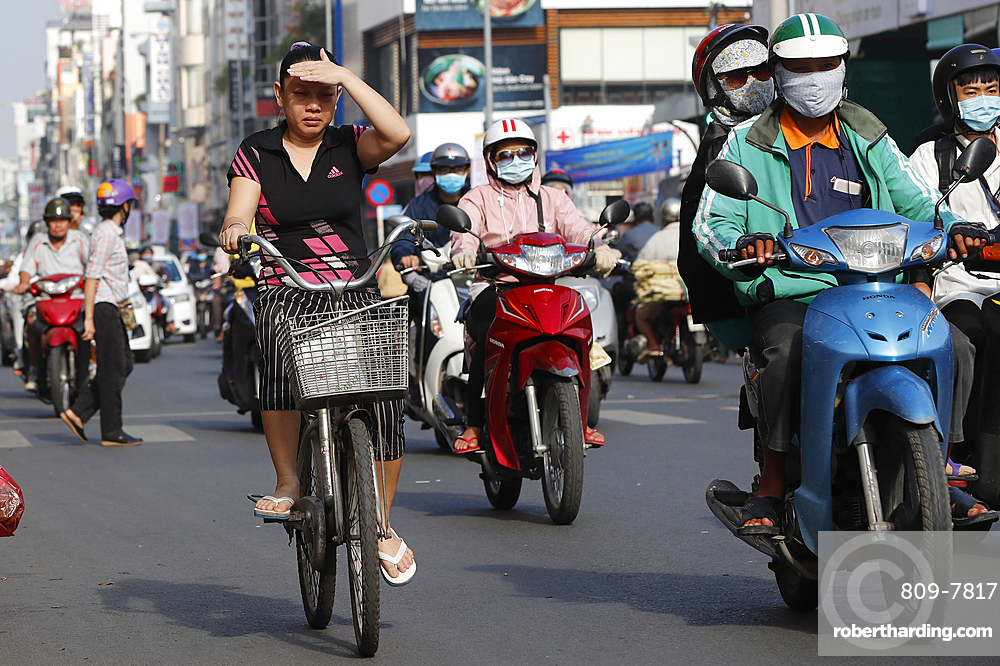 Bicycle and motorbikes on traffic road, Ho Chi Minh City, Vietnam, Indochina, Southeast Asia, Asia