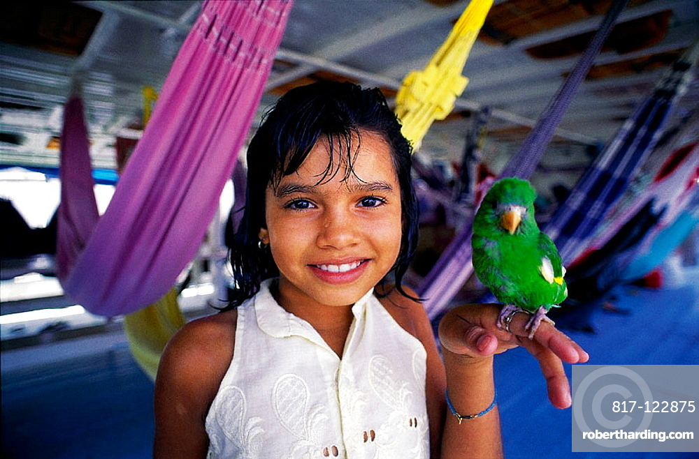 Little girl with parrot on the boat from Manaus to Belem, Amazon River, Brazil