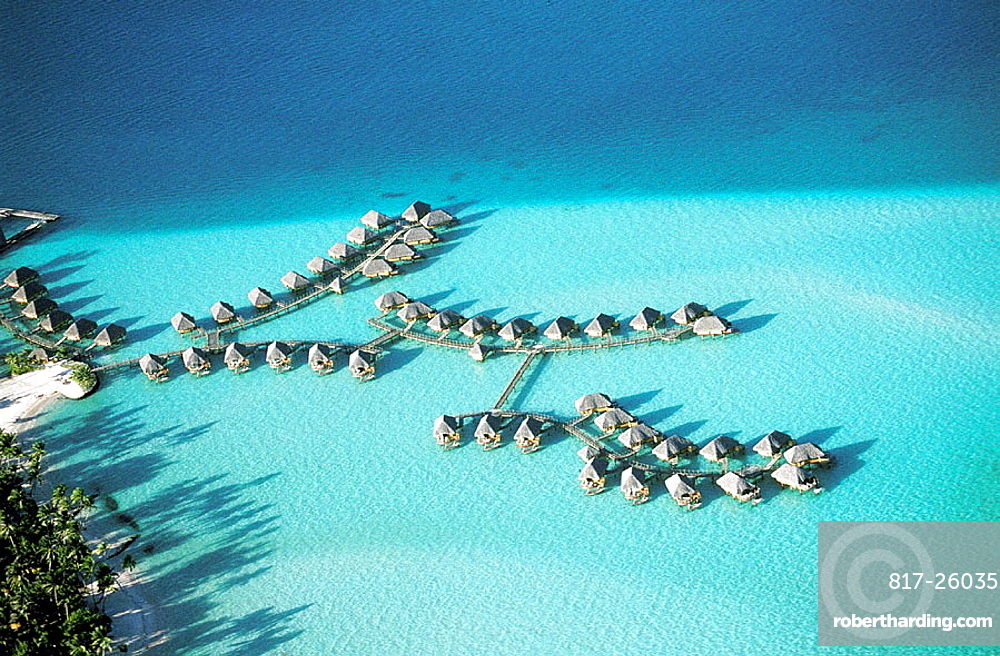 Aerial of luxury hotel huts built on piles on the lagoon, Bora Bora, Leeward Islands, French Polynesia