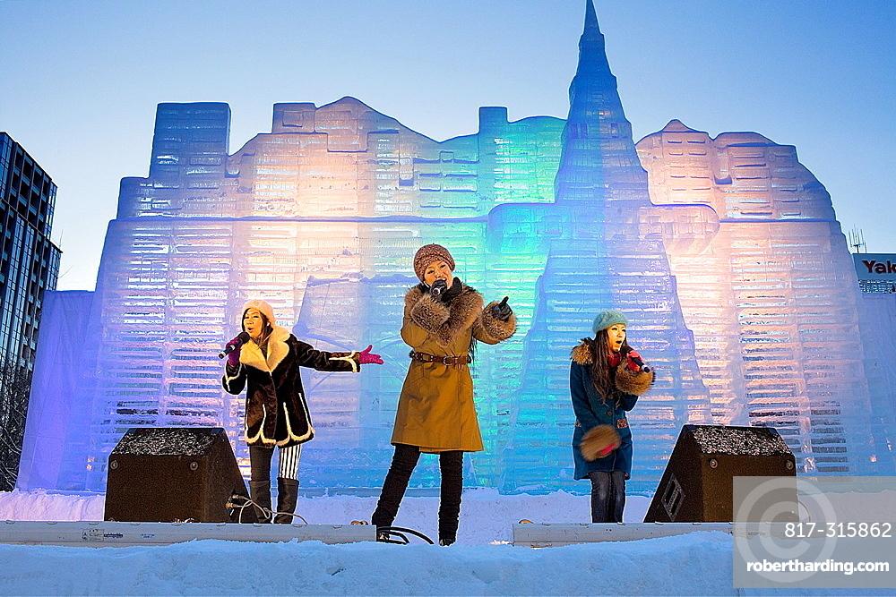 performance, Sapporo snow festival, in background ice sculpture, Odori Park, Sapporo, Hokkaido, Japan