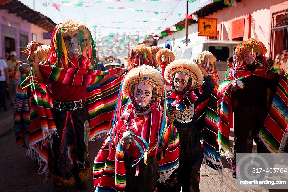 Traditionally dressed mayan people wearing masks in the celebration of the feast day Our Lady of Guadalupe which is the patron saint of Americas, San Cristobal de Las Casas, Chiapas, Mexico, Central America.