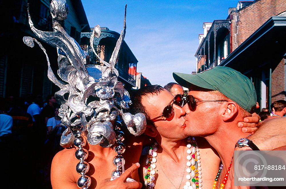 Men kissing, Fat Tuesday, New Orleans carnival, Louisiana, USA