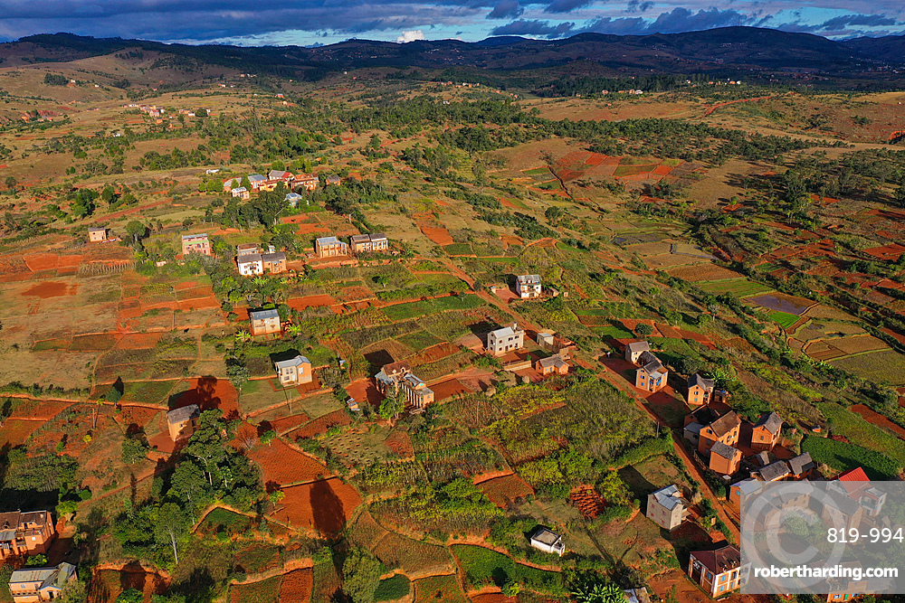 Rice fields and small mud villages near Sandrandahy, on the National Route RN7 between Ranomafana and Antsirabe, Madagascar