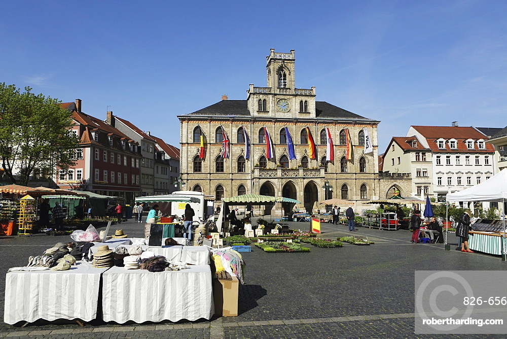 The City Hall (Rathaus) and market stalls on the cobbled Market Place (Marktplatz) in Weimar, Thuringia, Germany, Europe