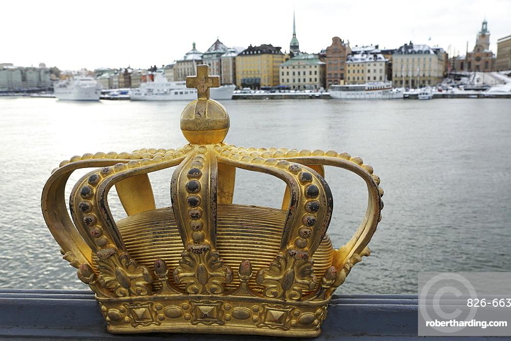 A gilded Swedish crown on the Skeppsholm Bridge (Skeppsholmsbron) in Stockholm, Sweden, Scandinavia, Europe