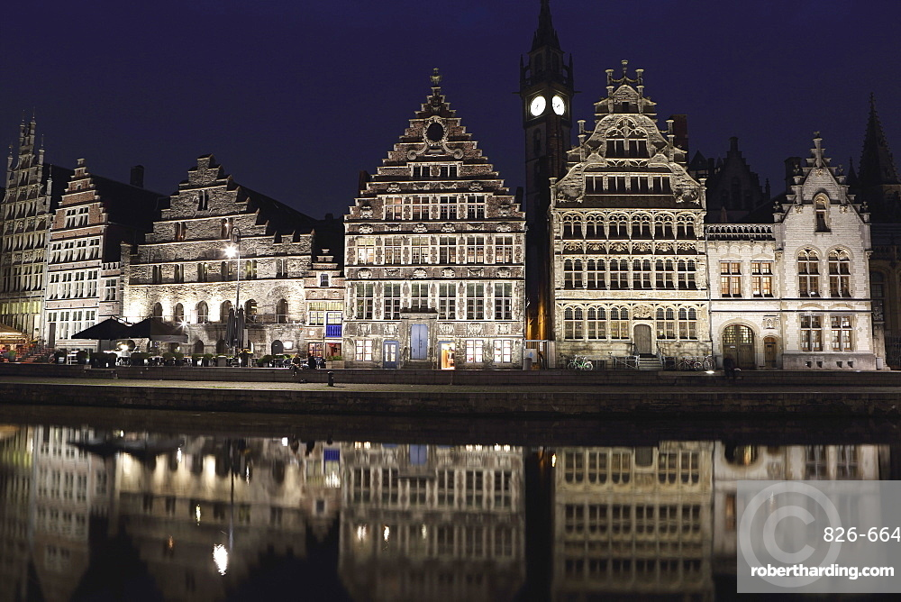Gothic buildings on the waterfront Graslei reflect in the Leie canal, at night in central Ghent, Belgium, Europe