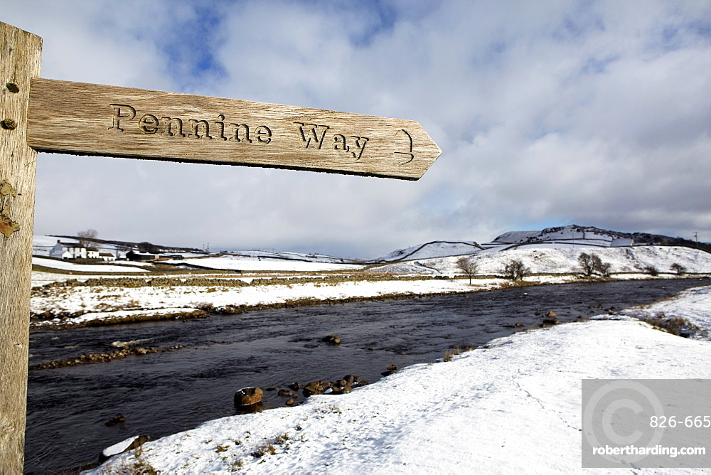 Sign for the Pennine Way walking trail on snowy landscape by the River Tees, Upper Teesdale, County Durham, England, United Kingdom, Europe