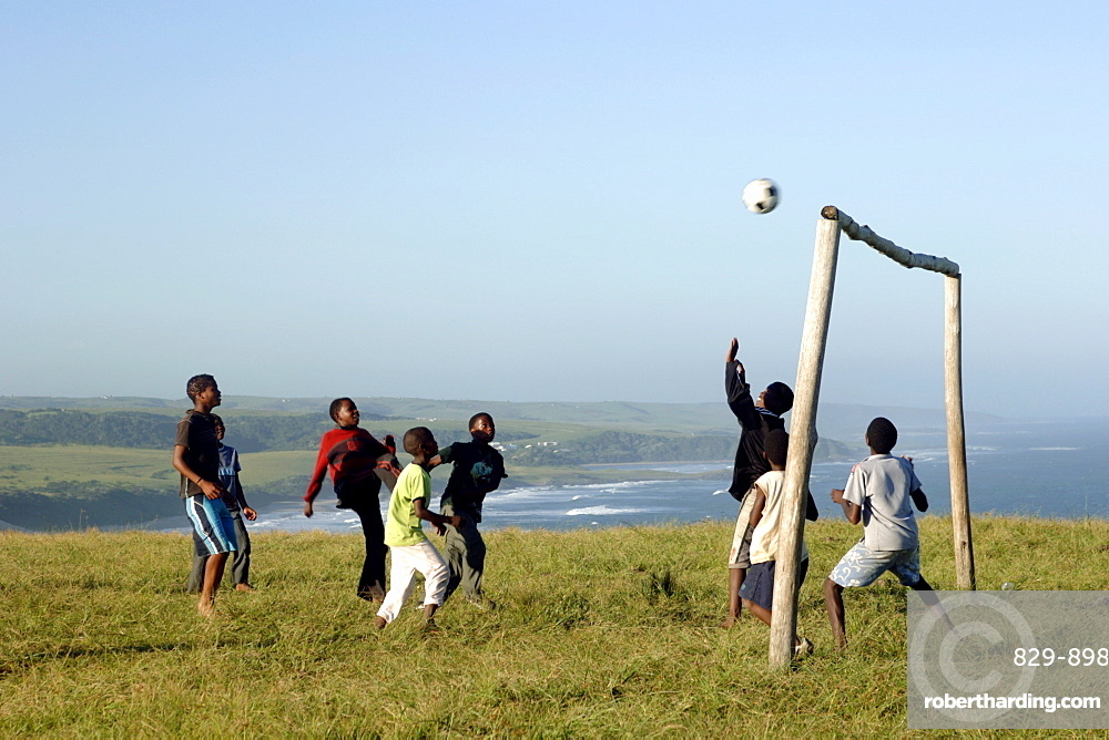 Young Xhosa boys playing football on a hill near Mazeppa Bay in the Eastern Cape Province of South Africa.