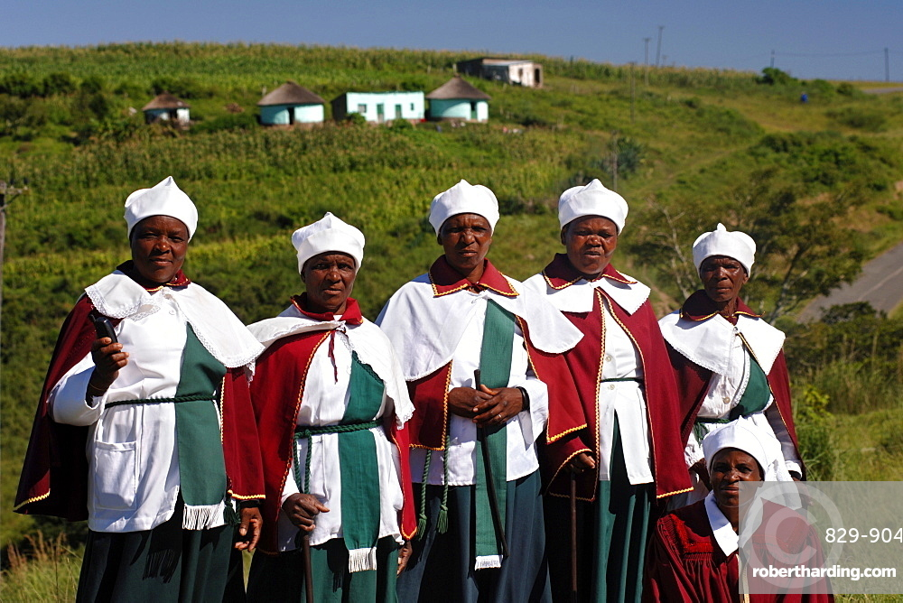 A group of Xhosa women pose for a photo in the Eastern Cape Province of South Africa. This is an area along the Coffee Bay road in a region formerly known as the Transkei,