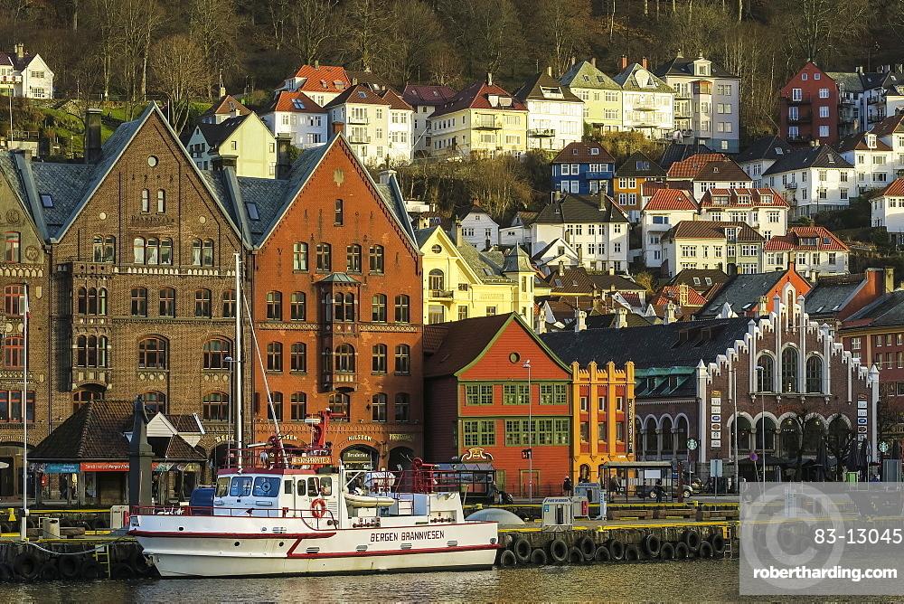 Wooden Hanseatic Museum and castellated Kjottbasaren shopping centre on right on the Bryggen waterfront, UNESCO World Heritage Site, Bergen, Hordaland, Norway, Scandinavia, Europe