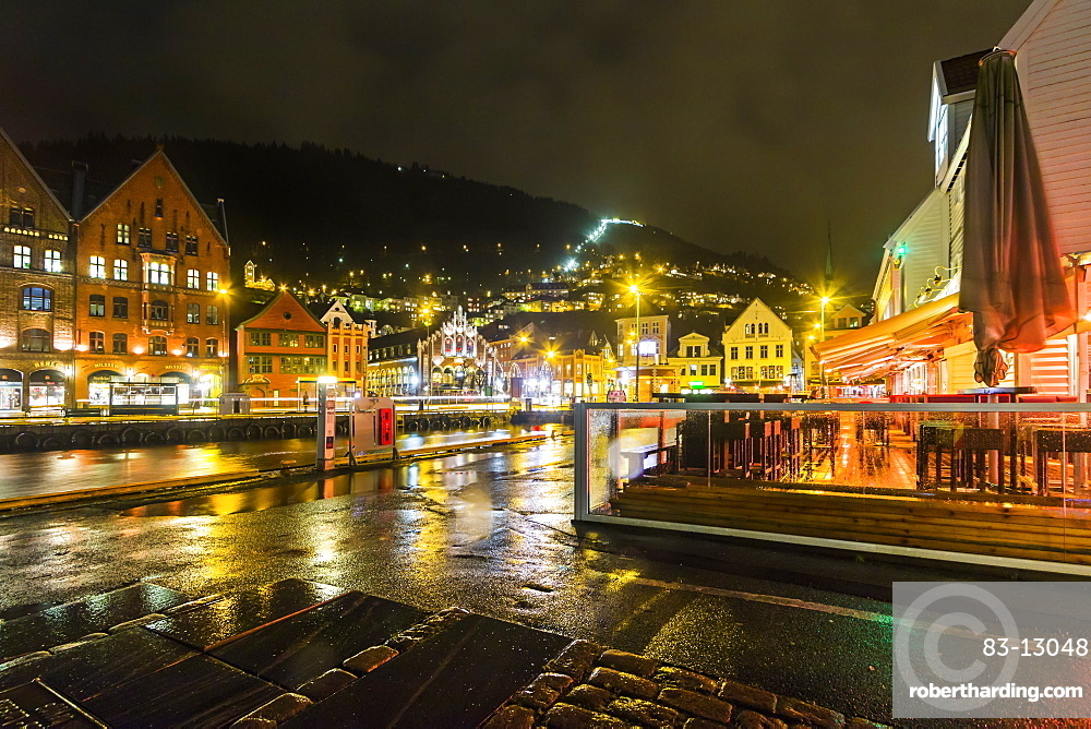 The Fjord Restaurant by Vagen Harbour with the Bryggen waterfront and funicular rail beyond, at night, Bergen, Hordaland, Norway, Scandinavia, Europe