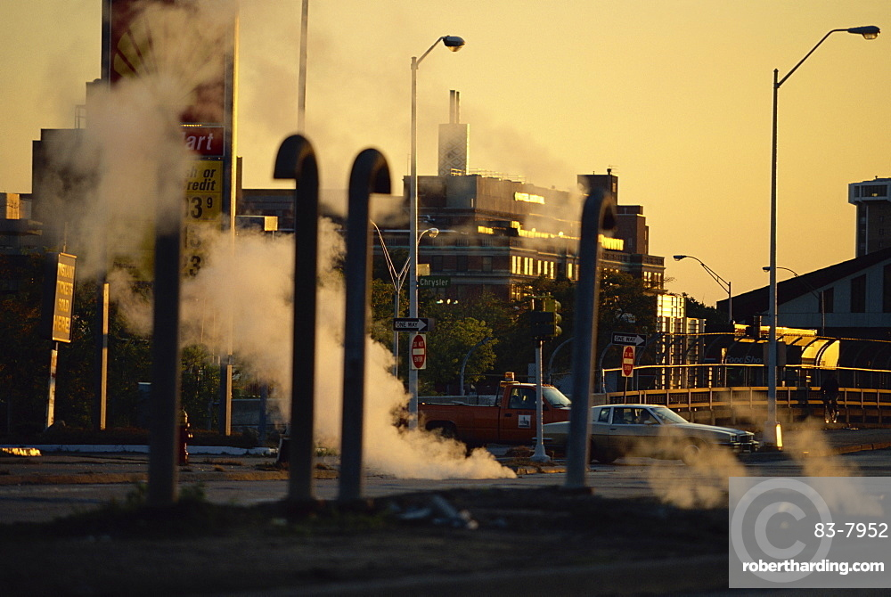 Steam escaping from below street at dusk, Hamtramck, a Polish inner city area, Detroit, Michigan, United States of America, North America