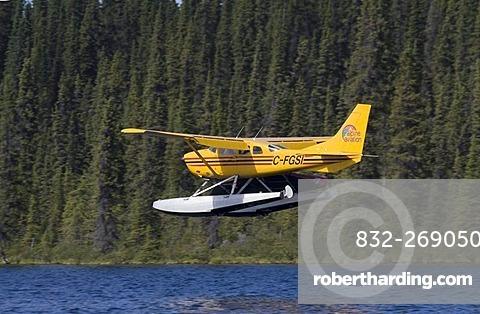 Landing float plane, bush plane,   Stock Photo