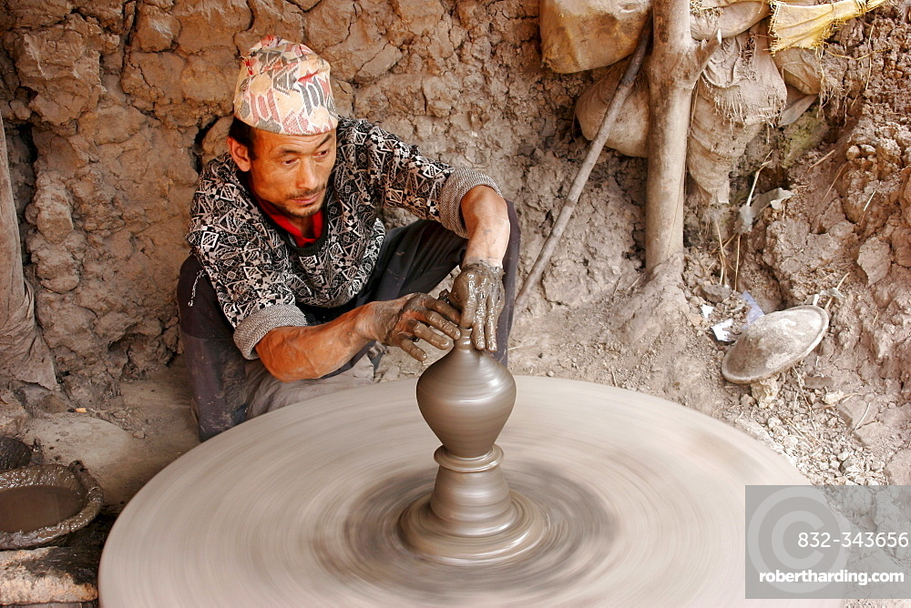 Potter at work on an outdoor pottery square in Bhaktapur, Nepal