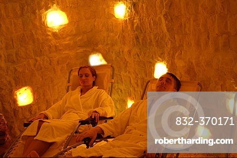 Woman and man relaxing in salt cave