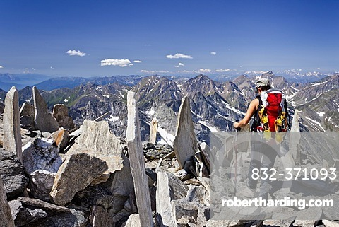 Mountaineer descending from Hochfeiler mountain, Pfitschertal valley, Pfitschertal valley and Wipptal valley at the back, province of Bolzano-Bozen, Italy, Europe