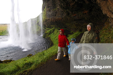 Woman and two children at Seljalandsfoss, Iceland, Europe