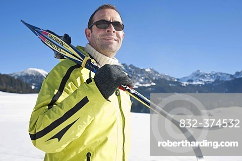 Man with cross-country skis in the mountains