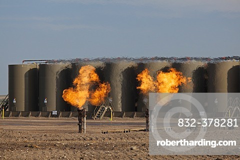 Natural gas is flared off as oil is pumped in the Bakken shale formation; the gas is burned because no pipelines have been built to transport it to market, Watford City, North Dakota, United States, North America