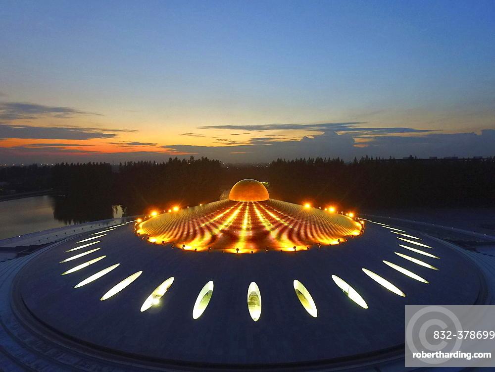 Phra Mongkol Thepmuni Memorial Hall, illuminated golden dome of the Phramonkolthepmuni meditation hall, Khlong Luang District, Pathum Thani, Bangkok, Thailand, Asia (Drone)