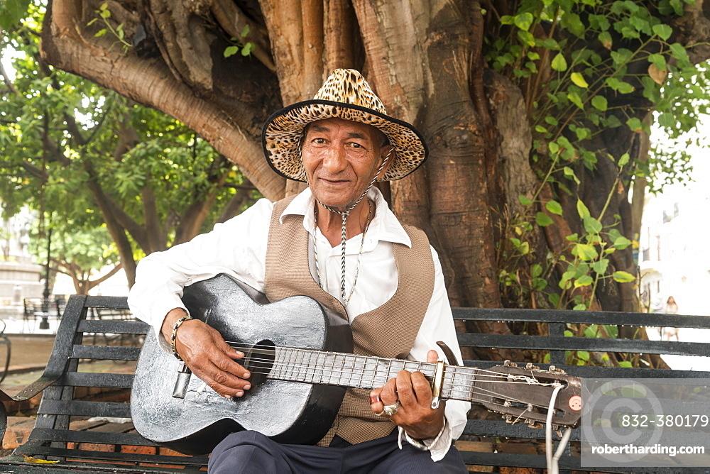 Street musician with guitar, Santo Domingo, Dominican Republic, Central America