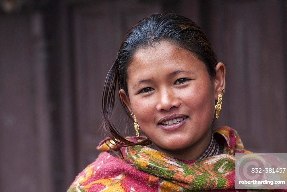 Young Nepali woman with earrings, portrait, Bhaktapur, Nepal, Asia