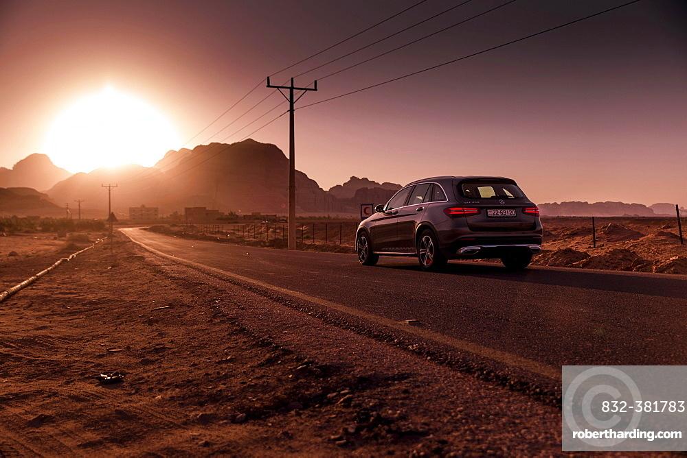 Mercedes Benz GLC250 SUV on the road, Sonenuntergang in Petra, Jordan, Asia