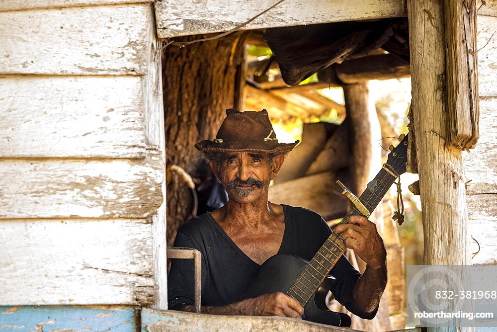 Sugar cane farmer playing the guitar, Valle de los Ingenios, Trinidad, Sancti Spiritus Province, Cuba, Central America