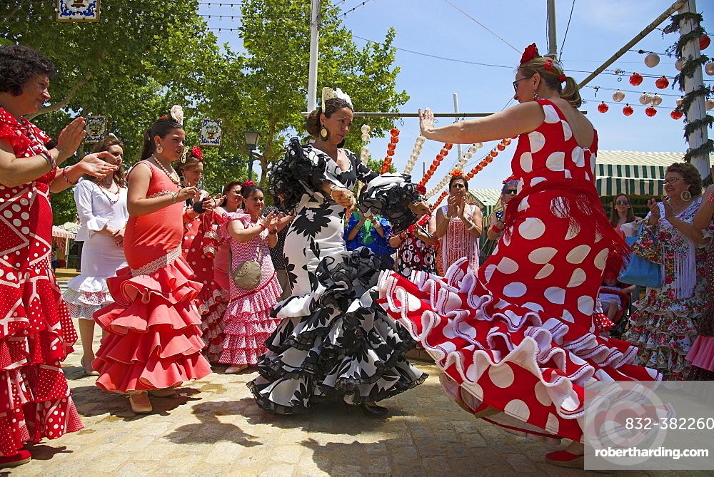 Flamenco dancers at the Feria de Abril, Seville, Andalucia, Spain, Europe