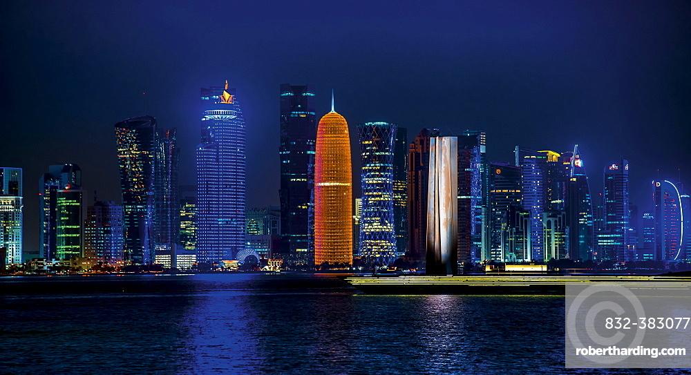 Night scene of the skyline of Doha with Al Bidda Tower, World Trade Center, Palm Tower 1 and 2, Burj Qatar Tower, Doha Corniche, Doha, Qatar, Asia