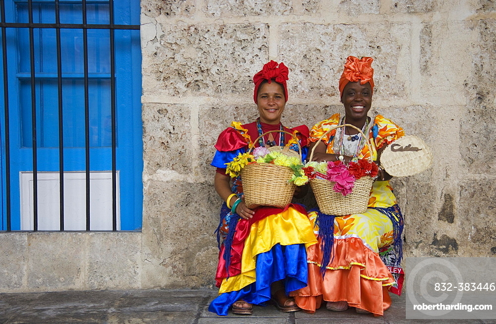 Two women wearing colourful dresses, Havana, Cuba, Central America