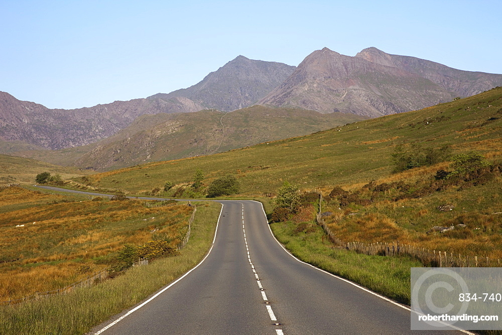 Empty road with Mount Snowdon in background, Snowdonia National Park, Gwynedd, Wales, United Kingdom, Europe