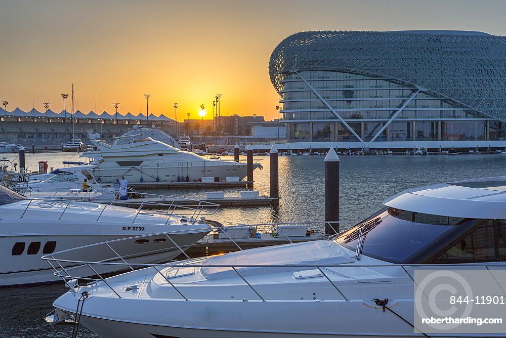 The Yas Viceroy Hotel and Yas Marina at sunset, Yas Island, Abu Dhabi, United Arab Emirates, Middle East