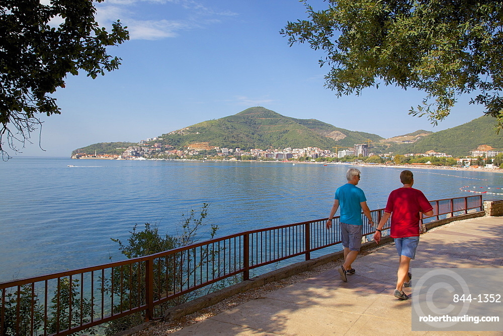 Walkers and Old Town, Budva Bay, Montenegro, Europe