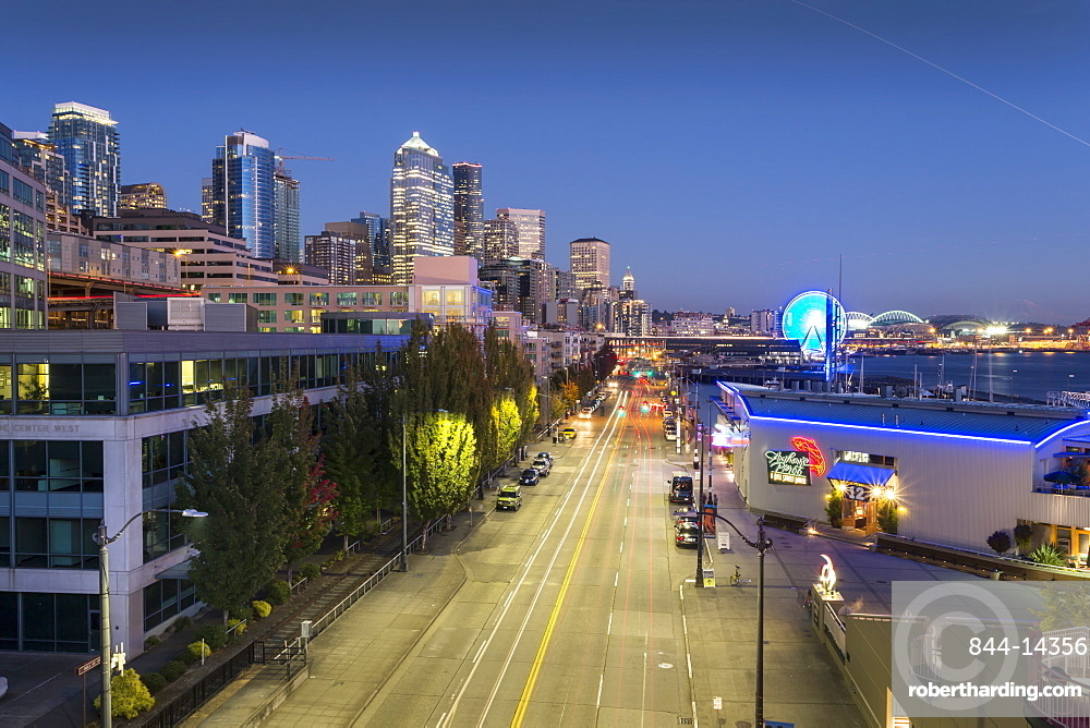 Elevated view of Seattle Skyline and traffic on Alaskan Way at dusk, Belltown District. Seattle, Washington, USA, North America