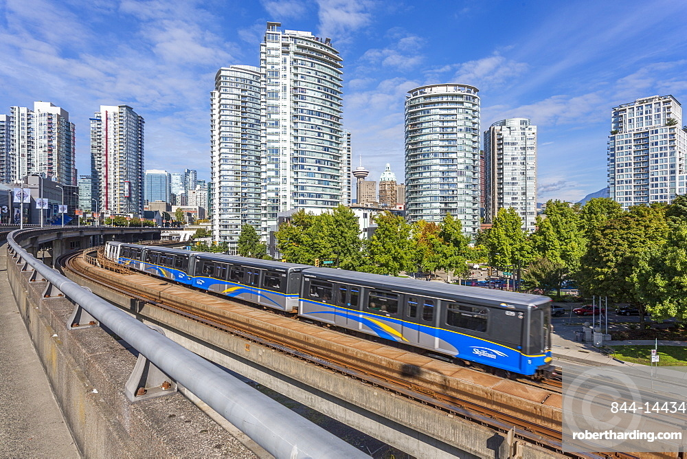 View of Metro Train and urban office blocks and apartments, Vancouver, British Columbia, Canada, North America