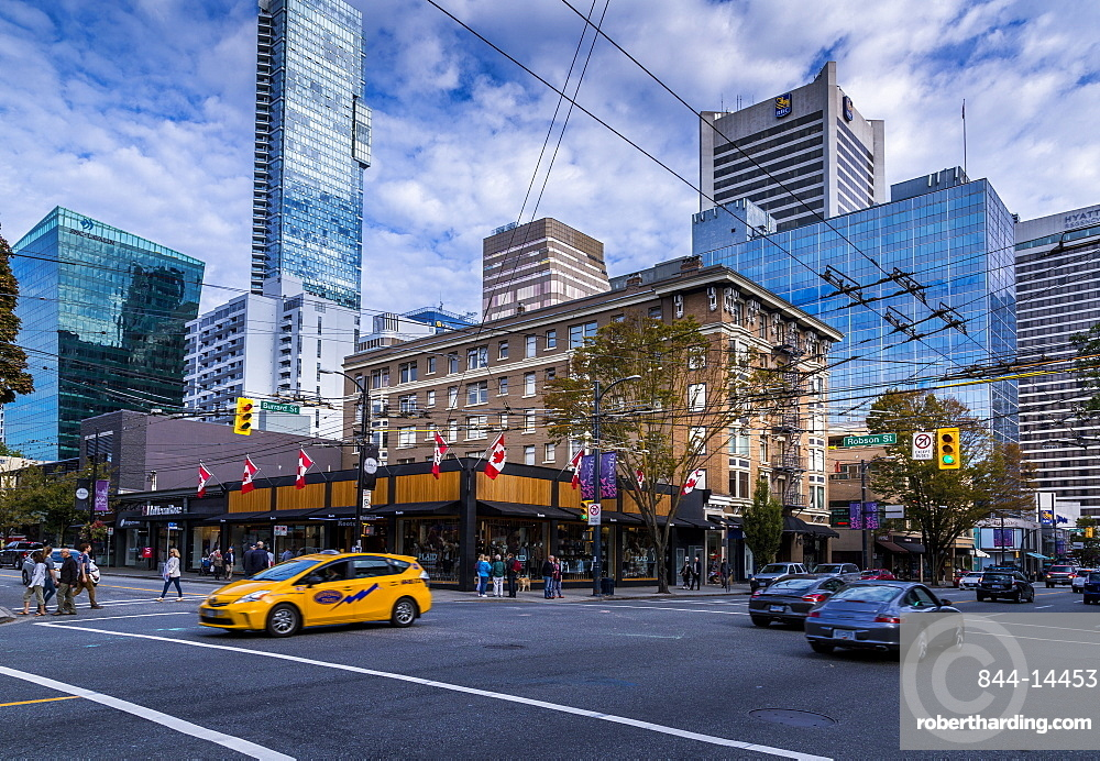 View of traffic and shoppers on Robson Street, Vancouver, British Columbia, Canada, North America