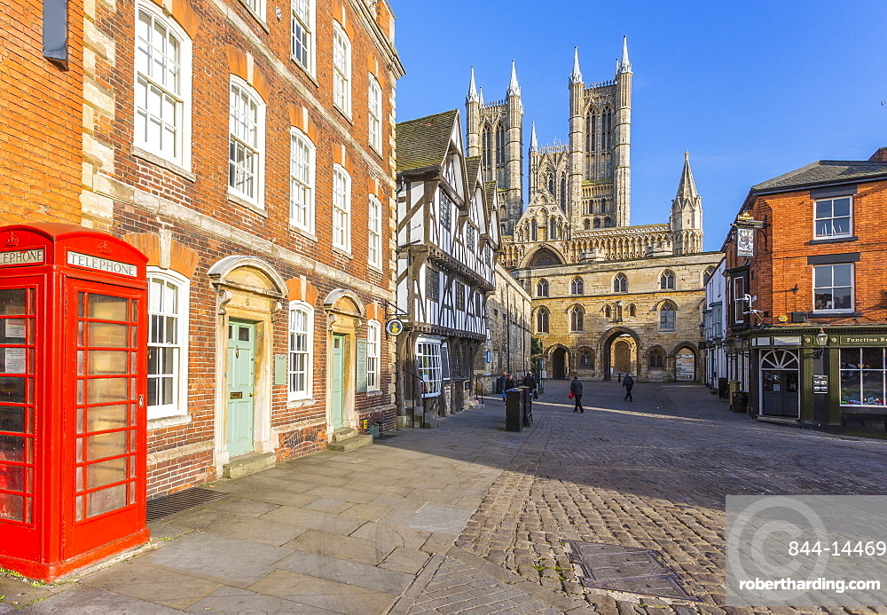 Lincoln Cathedral viewed from Exchequer Gate with red telephone visible, Lincoln, Lincolnshire, England, United Kingdom, Europe