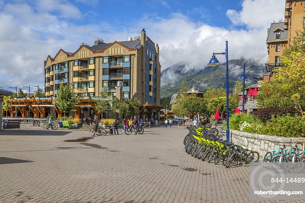 Cycles and shops aligning Skiers Plaza , Whistler Village, British Columbia, Canada, North America