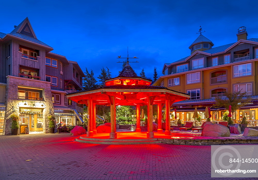 Illuminated bandstand on Village Stroll at dusk, Whistler, British Columbia, Canada, North America
